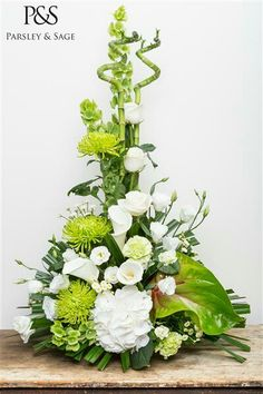 Classic Green and white arrangement available to buy on our new mobile friendly website www.parsleyandsage.co.uk #florist #floriststokeontrent