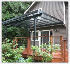 Beautiful deck and glass awning by Little Star Renovations | VIa HomeStars.