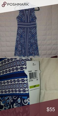 London Times jersey v-neck dress NWT Soft jersey fabric with stretch.  Navy floral and tribal design.  Brand new condition with original manufacturer's tags attached. Dresses Midi