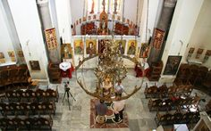 The Holy Synod, the ruling body of Greece's Orthodox Church, agreed on Monday to suspend all daily services and sacraments for an indefinite period as part of the government's efforts to contain the spread of the new coronavirus. Holi, Greece, Chandelier, Ceiling Lights, Period, Greece Country, Candelabra, Chandeliers, Holi Celebration