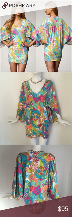 NWT Trina Turk Tangiers Kimono Tunic swim Dress Never one to shy away from color, Trina Turk splashes the Tangiers tunic with fun, vivid hues to make sure you turn heads on your next vacation. Slip on the coverup when you're headed to the beach or to cocktails by the pool. Turquoise/multicolor printed jersey. V neckline. Three-quarter batwing sleeves. Fits loosely at bust, waist; fitted at hip. Hem hits mid-thigh. Rayon/spandex. Made in USA.  NWT size medium Trina Turk Swim Coverups