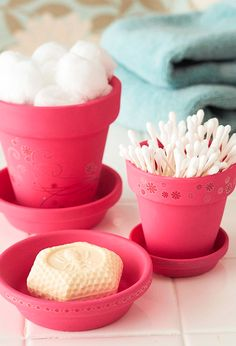 Make a cute bathroom set that will match perfectly. Just grab a couple of those terra cota planters that you can find at garage sales for practically nothing and decorate them. You could use these for many purposes other than in the bathroom.  Also could use tea cup and saucer or pitcher and basin.