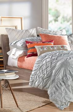 Love this bedding! The coral pops against the grey.