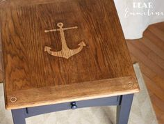 Add an anchor stencil to a coffee table: http://www.completely-coastal.com/2016/03/nautical-anchor-coffee-table.html