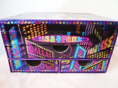 Super cute CHICA Lisa Frank stash box!!!! Great for holding jewelry, supplies, secret stashes....whatever you can think of!!! A sturdy cardstock box, with 3 pull out drawers and the top flap-style drawer. Drawer is in great condition, the only flaw is the bottom left drawer which has some yellowish staining. Appears to be paint or marker. Everything else is great - very few marks on the outside, no large tears or dents. Drawer measures 8.25 x 6.5 x 5.    Thank you for looking