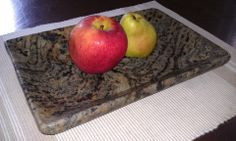 Fruit bowl made from recycled stone. This is my wifes favorite stone color right now. It looks almost like tiger stripes. She also has a matching serving tray/cutting board  made out of it. The natural beauty of stone always takes my breath away. www.EcoGraniteGroup.com