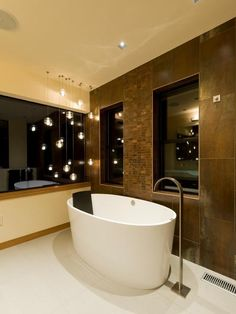 An array of Bocci 14.1 pendants used to create a relaxed ambience in a modern bathroom surrounding.