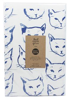 We're obsessed with Leah Goren's cat gift wrap :)