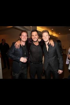 Luke Bryan and Florida Georgia Line. <3 these men right here are amazing! They have amazing voices. :) favorite male singers right here.