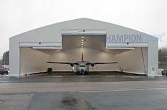 Champion Door fabric fold-up hangar doors for aircraft hangars from military fighters to jumbo jets. Reliable and long-lasting hangar doors with low maintena. Jumbo Jet, Exterior Doors, Weather Conditions, Champion, Aircraft, Military, Technology, Home, Design