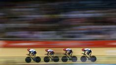 Edward Clancy, Geraint Thomas, Steven Burke and Peter Kennaugh of Great Britain compete in the men's Team Pursuit Track Cycling final.