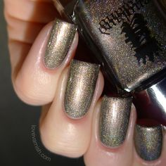 England Virgin Queen is a very unique color. I'm not sure what to call it.. light olive? Charcoal? Olive-taupe? And then there's the lovely holographic finish to it.. sparse, scattered but sparkly! I think this'll work for stamping very well too!