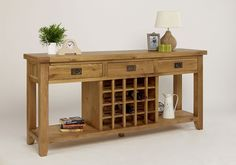 Provence Oak 3 Drawer Console/Wine Table - The Provence Oak 3 Drawer Table from TFW Furniture incorporates an innovative centralized wine rack, making it ideal for storing up to 20 of your favourite bottles, this is perfect for any styled home. Often used in its traditional sense the Provence table helps to divide a larger room and gives an ideal place to feature table lamps and ornaments. In a smaller room it favors use as a console or slim line sideboard creating a sense of space thanks to…