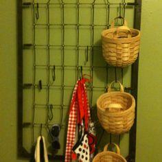 Fun wall hanging storage. Flat springs from baby crib.
