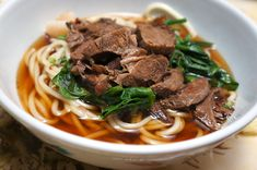 A steaming bowl of beef noodle soup is the ultimate in Chinese comfort food. This recipe looks long, but it's simple - beef shank slow-braised in soy sauce and wine, ginger and green onions. Serve ...