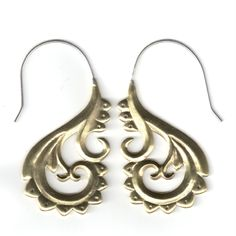 Traditional Maori inspired design meets metal in these fusion earrings.  Hand cast out of brass and tumbled for a high polish. The ear wire is nickle-free sterling silver and flows into brass for a fantastic golden gleam.