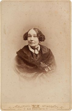 """Mrs. Albert Sidney Johnston Cabinet Card, circa 1870s. 4.25"""" x 6.5"""", sepia toned. This photograph features Eliza Griffin Johnston, the second wife of Confederate General Albert Sidney Johnston. The two made their home in Brazoria County. Lower margin and verso are stamped with the seal of """"Bradley and Rulofson, San Francisco""""; the backstamp boasts of """"the only elevator connected with photography in the world."""""""