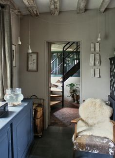 love the collected finishes, and the matte french grey walls.