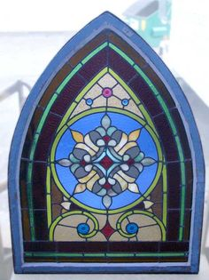 Colorful gothic arch stained glass with four jewels