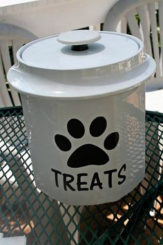 I purchased this ice bucket from a thrift store for $1.  Then cut out some vinyl on the cricut.  Dog Treats.