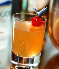 A bold and brassy combination of GREY GOOSE Cherry Noir Flavored Vodka, DEWAR'S® WHITE LABEL® Blended Scotch Whisky, sweet vermouth, citrus, soda water and homemade oleo-saccharum.