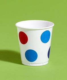 Turn plain white cups into custom-designed party wear with simple dot stickers, available at any office supply store.