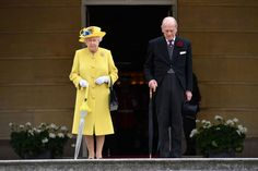 Queen Elizabeth II and Prince Philip, Duke of Edinburgh observe a minute's silence in honour of the victims of the attack at Manchester Arena at the start of a garden party at Buckingham Palace on May 23, 2017 in London, England.