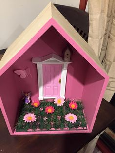 All little girls need a fairy door made out of Kmart decorating boxes