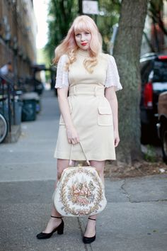 Street style captured by Calivintage. I love the black pumps paired with the pastel/cream outfit. That tapestry bag. The peachy pink hair. Everything is perfect!