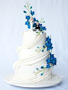 I kind of like this cake style, minus the fondant and cheesy, figurines. Add real flowers-- Matt