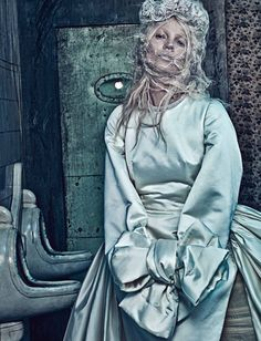 Kate Moss for W Magazine shot by Steven Klein and styled by Edward Enninful. Kate Moss wears Comme des Garçons' silk satin dress and headpiece by Paul Hanlon.