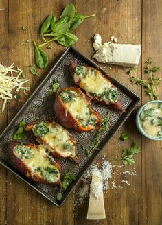 Sweet potatoes baked with a delicious filling of three-cheese sauce and spinach. Spinach is one of the starring ingredients on the Future 50 Foods list! Spinach Bake, Grated Cheese, New Cookbooks, Cheese Sauce, Vegetarian Food, Food Lists, Sweet Potato, Food Ideas, Potatoes