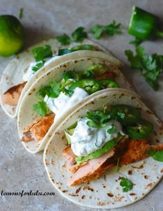 Salmon Tacos with Jalapeño Cream  1 ½ pounds fresh salmon 1 teaspoon chili powder ¾ teaspoon cumin ½ teaspoon onion powder 1 teaspoon paprika ¾ teaspoon salt ¾ teaspoon pepper 2 tablespoons olive oil 8 6 -in tortillas 1 cup sour cream 4 tablespoons lime juice 3 tablespoons cilantro, chopped 1 jalapeno, diced pinch of salt