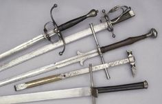 A variety of handsome swords, plus one war hammer.