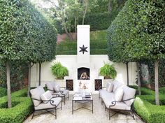 Designed by Art Luna, a handsome outdoor fireplace, ornamented with an iron star, sets the stage for elegant outdoor entertaining.