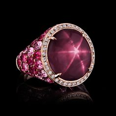21 carat star ruby, unheated, and set with rubies and pink sapphires and rose  gold. Robert Procop Exceptional Jewels