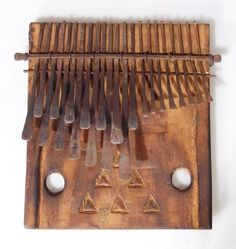 22 Key Large Rustic Shona Mbira/Kalimba from Zimbabwe by africancraftwork-com. $85.00. 22 keyed Large rustic Shona Mbira from Zimbabwe. The masterfully crafted keys have an exceptional tone to them and are very easy on your fingers. Hand made burnished wood sound board has a very ethnic appeal. When each key is made they use a master mbira to adjust each key to sound the same as that master mbiras keys ensuring it is tuned correctly. A fantastic instrument I guara...
