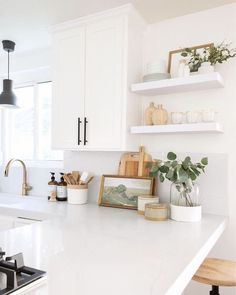 cottage kitchen design, white kitchen with white kitchen cabinets and marble counter with kitchen open shelf decor and black pendant light, eat in bar at traditional kitchen design, modern farmhouse kitchen White Kitchen Cabinets, Kitchen Countertops, Kitchen Shelves, Wood Shelves, Open Shelves, Kitchen Units, Sliding Shelves, White Countertops, Kitchen Taps