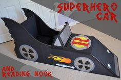 Super hero car made out of cardboard! What a great way to recycle! :)   It's made for kids to read in! Love!!!