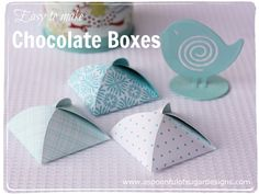 Easy DIY chocolate boxes. Can be made from scrapbook paper (and filled with any anything for party favors--not just chocolate!).