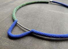 I used a mix of green and blue silk sewingthread to crochet one side of this necklace.  The other side was handcrocheted also with a 0.75 needle bu...