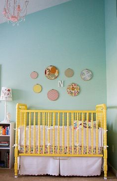 turquoise nursery with yellow crib