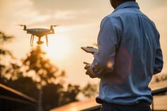 Man operating a drone with remote control, drone pilotage at sunset #paid, , #AD, #Affiliate, #drone, #remote, #sunset, #operating Drone Copter, Air Drone, Remote Control Drone, Photography Services, Drone Photography, Photography And Videography, Aerial Filming, Drone Filming, Drone Videography