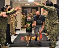 Mason Fletcher, 7, and his father Sgt. 1st Class Darrin Fletcher walk through an honor shield of applauding U.S. Army and Navy recruiting service members, prior to a surprise birthday party held for Mason, who has terminal brain cancer. Patriotic Poems, Army & Navy, Surprise Birthday, Boys, Brain, Cancer, Party, Baby Boys, The Brain