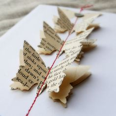 Flutter Handmade Card. Punch your choice of shape from pages of vintage books or sheet music. Layer and stitch onto the card with coordinating thread and embellish further to your taste.