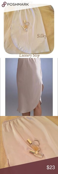 """CHAMPAGNE Luxury Satiny Slip Midi Length Beautiful slip. Satin polyester material with side slit. Great for movement under any dress or skirt. Gently preloved condition. 28"""" From waist to hem longest length. Farr West Intimates & Sleepwear Chemises & Slips"""
