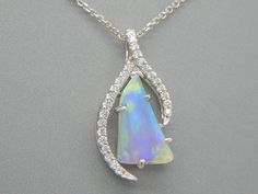 Do you like one-of-a-kind pieces of jewelry? This Australian Opal with diamonds will not disappoint you! #scottandco  At Scott & Co. Fine Jewelers we specialize in custom design jewelry serving but not limited to the following areas: Gettysburg, Hanover, New Oxford York, Lancaster, Carlisle, Chambersburg, Harrisburg (all of South Central) PA and Northern MD. Visit us at the square in New Oxford, at 2 Lincoln Way E, New Oxford, PA 17350 or call us at (717) 624-1444. scottandcofinejew...