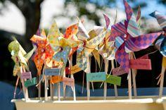 colorful pinwheel escort cards—   http://www.stylemepretty.com/little-black-book-blog/2011/12/02/diy-beaulieu-garden-wedding-from-gertrude-mabel-photography/