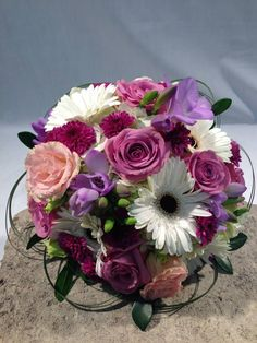 Wedding purple bouquet with roses, freesia, gerbera daisy and soft pink lisianthus.