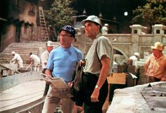 Disney Legend Claude Coats (right) with model maker Fred Joerger on the construction site of Pirates of the Caribbean.